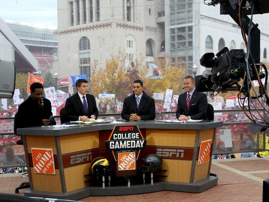 "The crew of ESPN ""College GameDay"" talks before the game between Michigan and Ohio State at Ohio Stadium in Columbus on Saturday, November 26, 2016."