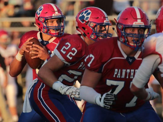Licking Valley quarterback Jake Lewis is able to scan the field against Johnstown, after getting solid protection from tackle Jarrod Hufford (77) and tailback Connor McLaughlin (22). Hufford is a First Team selection for the 2018 All-Advocate Football Team.