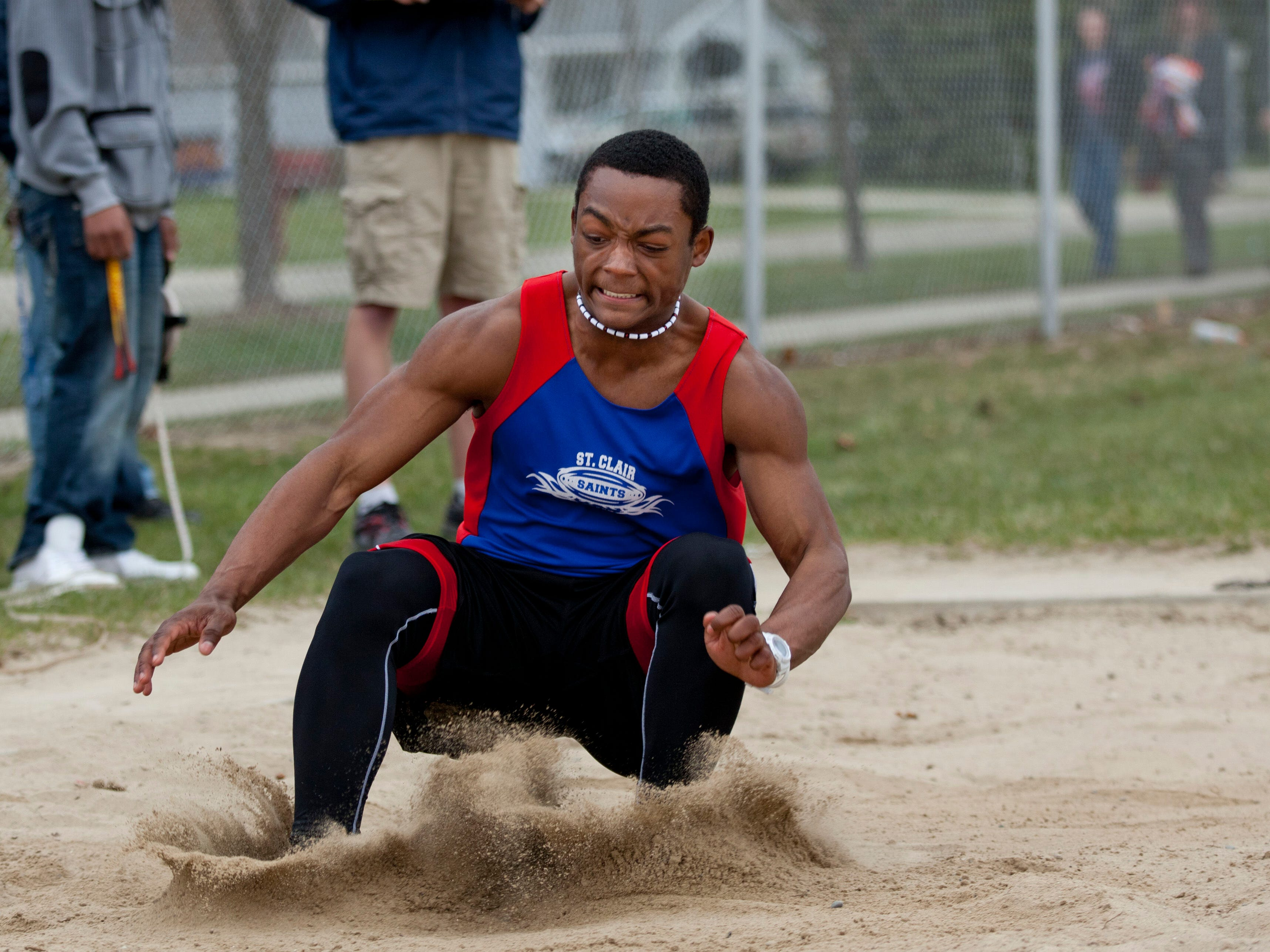 St. Clair sophomore Cameron Williams competes in the long jump during a track meet Thursday, April 30, 2015 at Marysville High School.