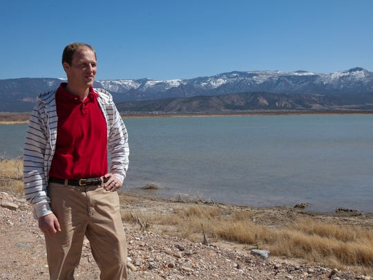 The general manager of the Central Iron County Water Conservancy District, Paul Monroe, stands near Lake Quichipa in March 2013.