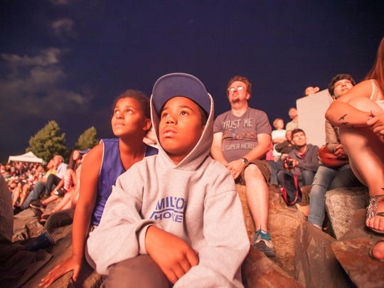 From left: Alexus Hess and her brother, Xavier, of Milton watch the Burlington fireworks in 2015.