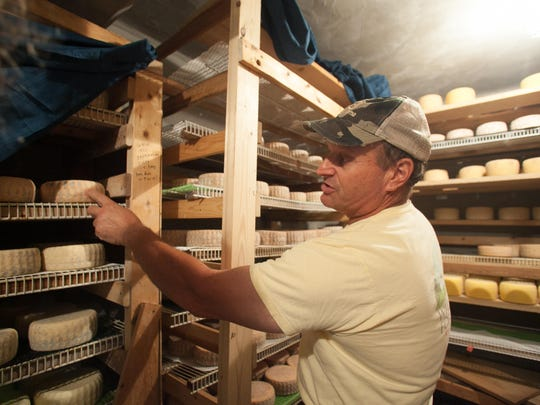Stan Biasini of Mt. Mansfield Creamery shows off cheeses