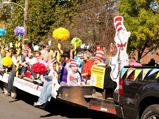 Westminster Preschool kids wave to bystanders during last year's Beaverdale Fall Festival parade in Des Moines.