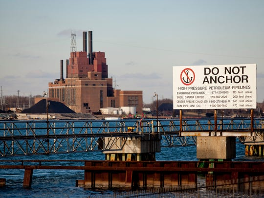A sign warns boaters of pipelines under the St. Clair River Friday in Corunna, Ontario.