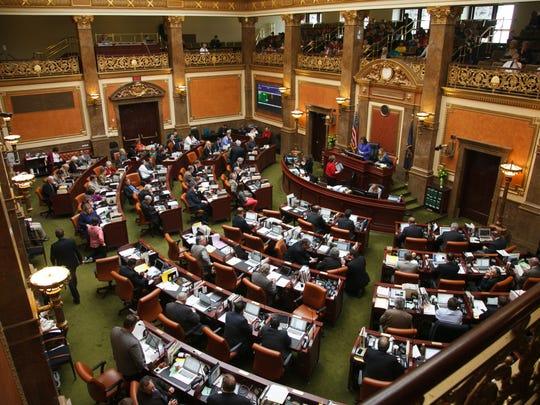 Members of the Utah House of Representatives work on