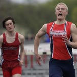 Appleton East's Gabe Heindel (right) won the 110-meter hurdles at the Fox Valley Association conference meet last year, but had to sit it out this season because of an injury.