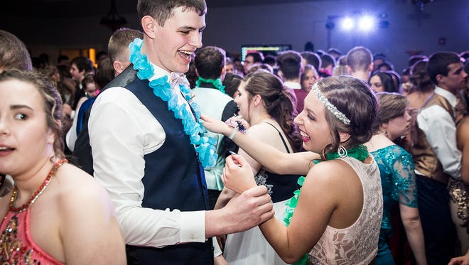 New Castle students celebrate prom at Blue Falls in Pendleton.
