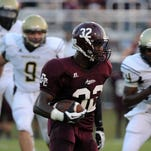 FCAHS's Dontavian Lee heads down field for a first down as they take on Bassfield. Lee now plays for Mississippi State.