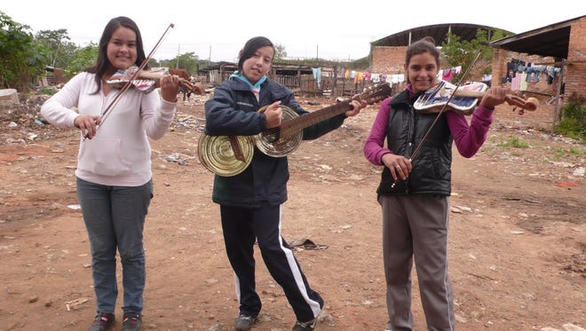 """""""Landfill Harmonic,"""" which looks at kids in a Paraguayan slum who play music on instruments made of rubbish, will be screened for free Wednesday, May 27."""