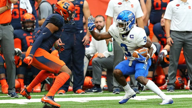 MTSU wide receiver Richie James looks to get past a Syracuse defender at the Carrier Dome on Sept. 9, 2017.