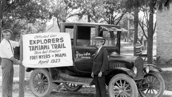 Tamiami trail blazers holding sign