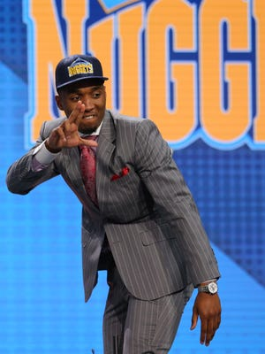Donovan Mitchell (Louisville) gestures on stage as he is introduced as the No. 13 overall pick to the Denver Nuggets in the first round of the 2017 NBA Draft at Barclays Center. He was then traded to the Utah Jazz.