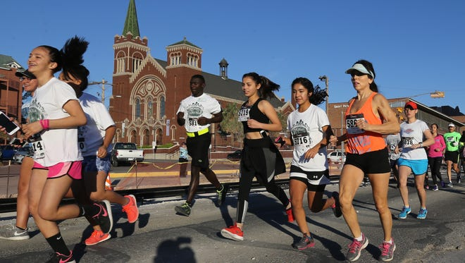 Runners made their way south on N. Stanton near St. Patrick Cathedral Saturday.