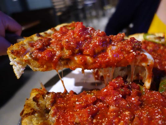 Deep-dish pizza at Buddyz A Chicago Pizzeria