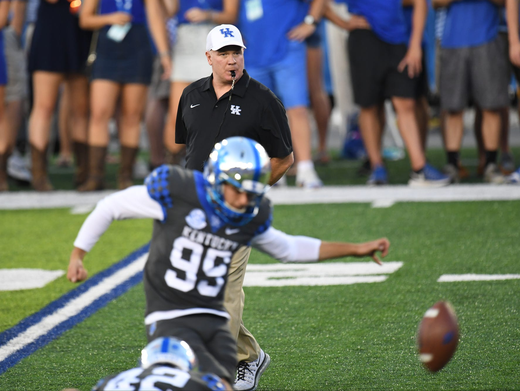 UK head coach Mark Stoops watches kicker Austin McGinnis warm up before the University of Kentucky football game against University of Florida in Lexington, KY on Saturday, September 23, 2017.