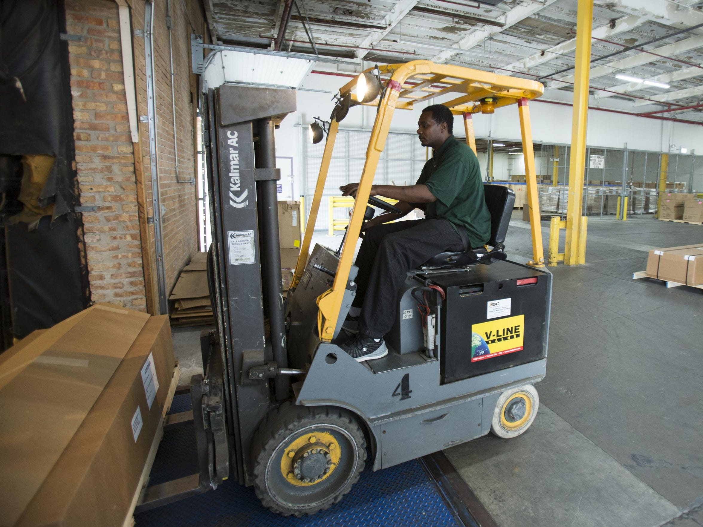 Keith Cooper operates a forklift at Rapid Displays
