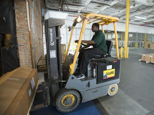 Keith Cooper operates a forklift at Rapid Displays in Chicago.