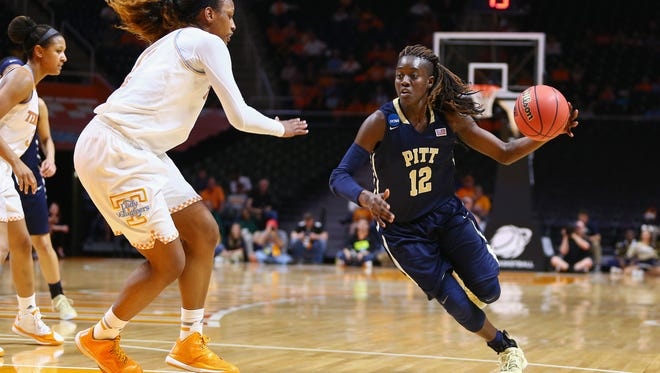 Mar 23, 2015; Knoxville, TN, USA;  Pittsburgh Panthers forward Yacine Diop (12) handles the ball during the game against the Tennessee Lady Volunteers in the second round of the women's NCAA Tournament at Thompson-Boling Arena. Mandatory Credit: Randy Sartin-USA TODAY Sports