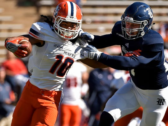 UTEP wide receiver Warren Redix (10) is tackled by Rice linebacker Nick Uretsky (21) during the second half of an NCAA college football game, Saturday, Nov. 19, 2016, in Houston. Rice won 44-24.