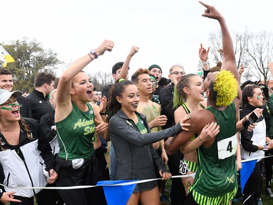 Adams State's Elias Gedyon (4) celebrates at the finish