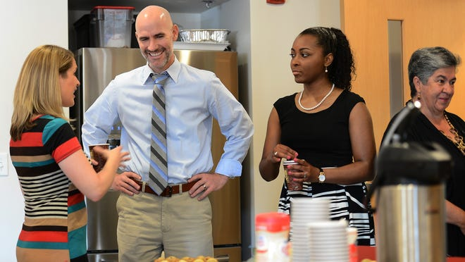 Todd Dickson, head of Valor Collegiate Academy, visits the Casa Azafra Community Center.
