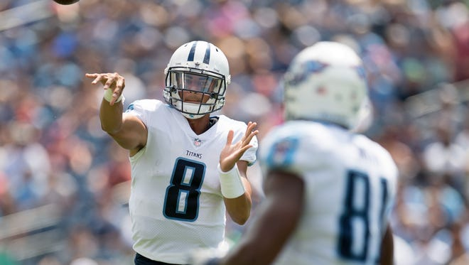 Titans quarterback Marcus Mariota (8) passes to tight end Jonnu Smith (81) against the Carolina Panthers during the first half of a preseason game at Nissan Stadium on Aug. 19, 2017.