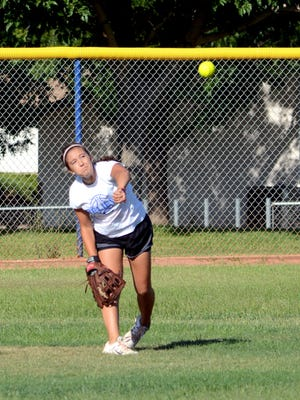 Carlsbad's Gabby Aragon throws to make a play at second base during Tuesday's practice.