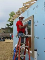 During Carter Work Week, 1,500 volunteers, including