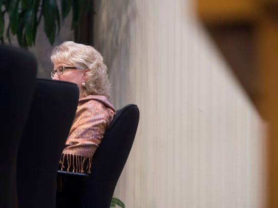 Knox County School Board member Lynne Fugate listens