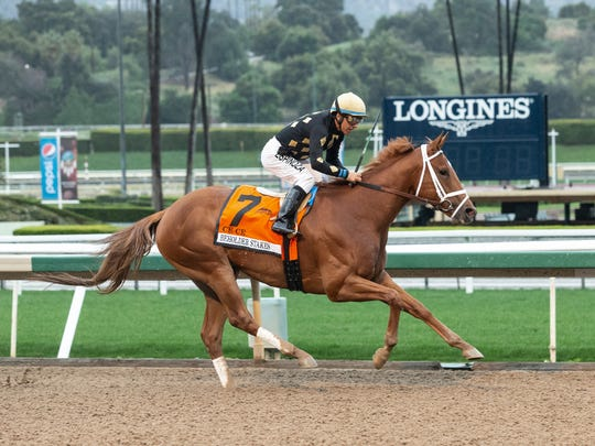 In this image provided by Benoit Photo, Ce Ce, with Victor Espinoza aboard, wins the Grade I, $400,000 Beholder Mile horse race Saturday, March 14, 2020, at Santa Anita Park in Arcadia, Calif. (Benoit Photo via AP)