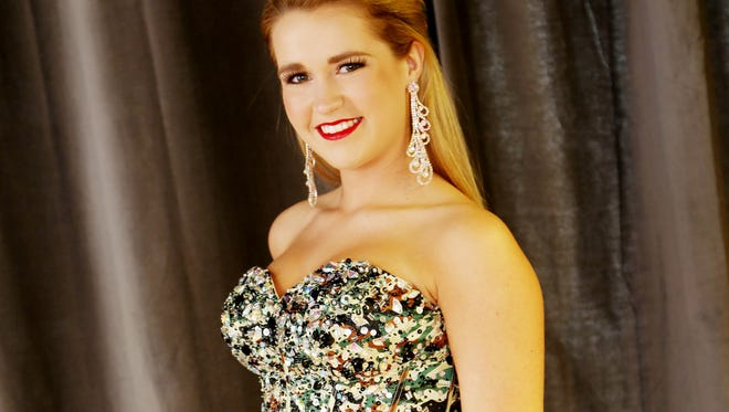 Emily Harney, Miss IA Jr Teen, in a green Camo ball gown S14101, it also comes in purple and blue for $425.