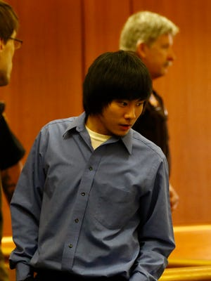 Dylan Yang enters the courtroom during his trial Thursday in Wausau.