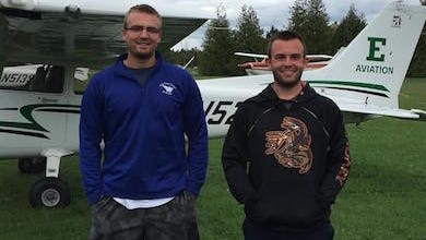 Josh Bamberger of Plymouth (right) won the landing contest during the Eastern Michigan University flight school's annual Poker Run this fall. Fellow student Jason Dickinson won the Poker Run itself, drawing the best hand of the journey.