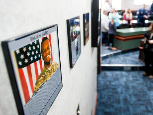 Plaques on the wall tell the story of Chester McBride