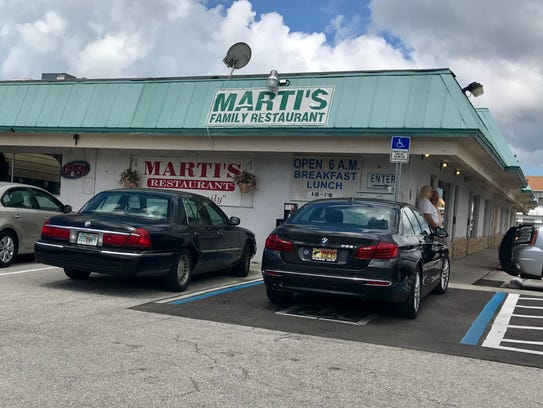 Marti's sits in a low, green-trimmed building on San