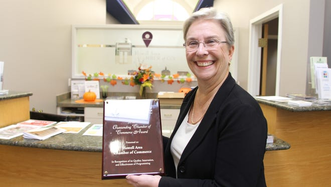 Howell Area Chamber of Commerce President Pat Convery holds the Outstanding Chamber of the Year award.