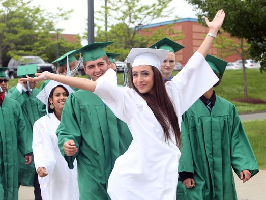 Brewster senior Vittoria Masi has some fun while waiting in line with her classmates during Brewster High School graduation ceremony at Western Connecticut State University n Danbury, CT. June 14, 2014.