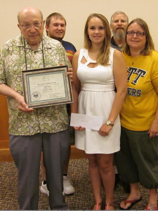 From left, are Kalman V. Illyefalvi, Chapter President; Tyler Hoke, recipient s brother; recipient Alison Hoke; Shawn Geiman, stepfather; and Jenifer Geiman, mother.