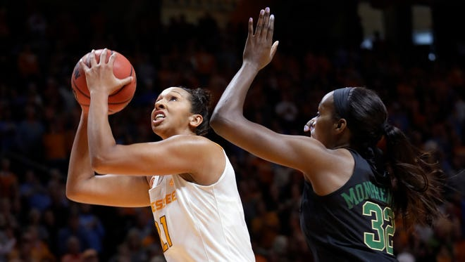 Tennessee center Mercedes Russell (21) shoots against Baylor center Beatrice Mompremier (32) in the first half of an NCAA college basketball game Sunday, Dec. 4, 2016, in Knoxville, Tenn. (AP Photo/Mark Humphrey)