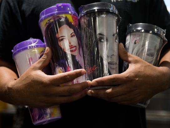 A man holds four limited edition Selena cups as he