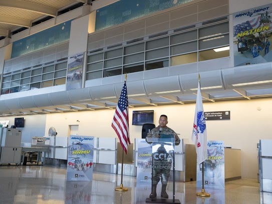 Col. Allan Lanceta, Commander of the Corpus Christi Army Depot, speaks during the unveiling of three banners on display at the Corpus Christi International Airport on Thursday, June 14, 2018. The banners were intended to honor the Army depot and its personnel.