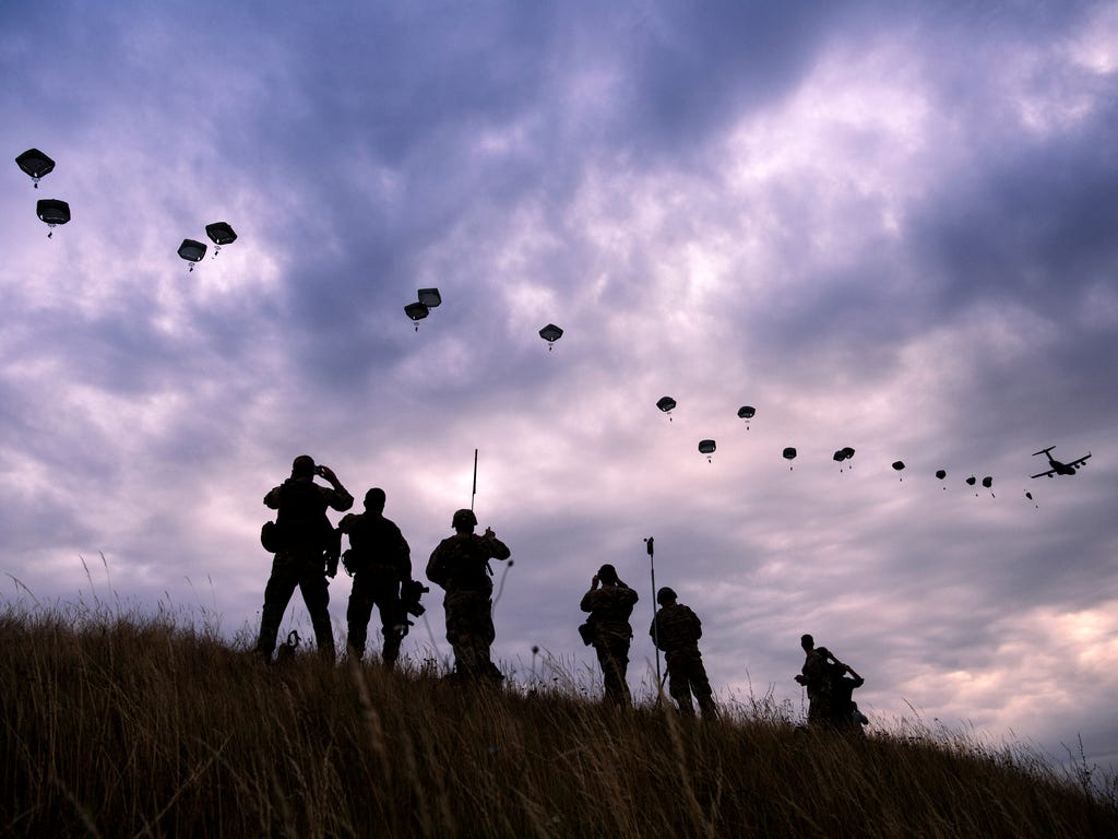 NATO paratroopers drop out of a U.S. Air Force C-130 Hercules during Swift Response 17 joint airborne military exercise at Bezmer Airfield near the village of Bezmer, Bulgaria. \u000dThe U.S. led exercise is part of Saber Guardian 2017 which involves