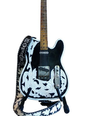 This Fender, which Waylon Jennings was holding on the jacket of the recording of the theme song for 'The Dukes of Hazzard' will be one of the items up for auction.