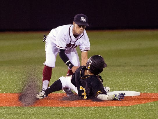 New Mexico State shortstop Brent Sakurai puts the tag