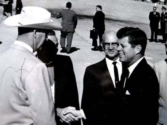 Palm Springs Mayor Frank Bogert (in the cowboy hat) greets President John F. Kennedy in 1962 at Palm Springs Airport.