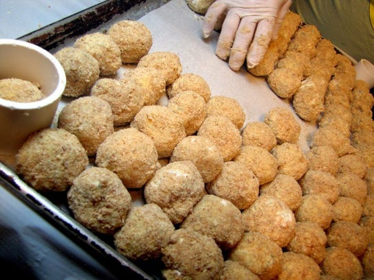 Kraut balls are shaped and frozen ahead of time by