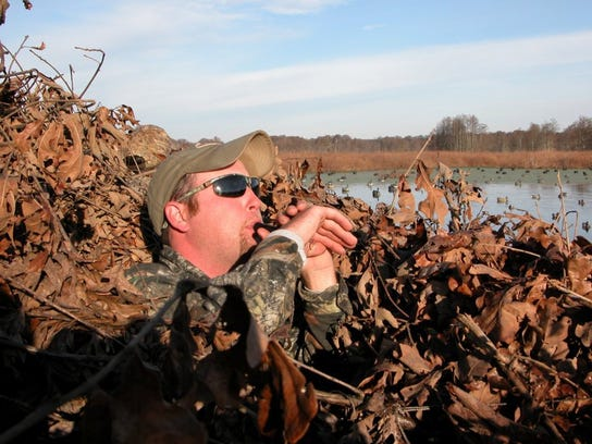 A Reelfoot Lake guide uses a a duck call.