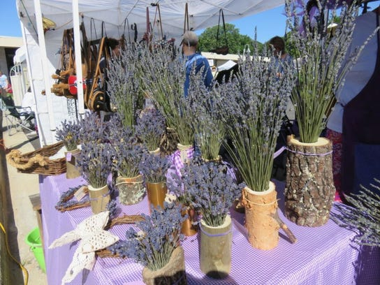 Some cut lavender in natural pots adorned the Midfield Farms booth at the 18th annual Lavender Festival in Oak Ridge.