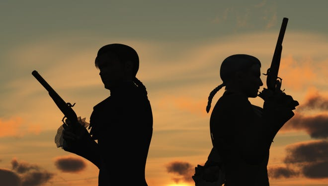 Two young men back to back with duelling pistols in silhouette against the dawn  preparing to take ten paces turn and fire.
