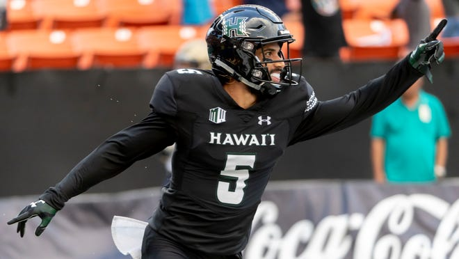 Hawaii wide receiver John Ursua (5) celebrates after catching a pass for a touchdown In the first half of an NCAA college football game against Navy, Saturday, Sept. 1, 2018, in Honolulu. (AP Photo/Eugene Tanner)